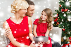 Smiling family with tablet pc Stock Image