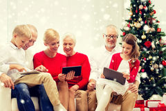 Smiling family with tablet pc computers at home Royalty Free Stock Photo