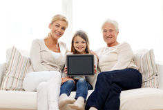 Smiling family with tablet pc at home Royalty Free Stock Photo