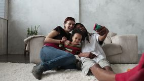 Smiling family taking selfie with mobile phone. stock footage