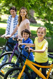Smiling family with their bikes Royalty Free Stock Images
