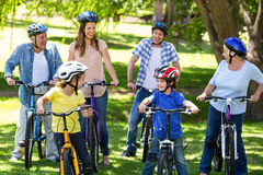 Smiling family with their bikes Royalty Free Stock Photo