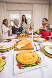 Smiling family toasting at christmas dinner Stock Photography