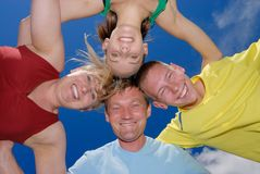 Smiling family together. Family holds together and smile at camera Royalty Free Stock Images