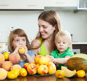 Smiling family together with melon Royalty Free Stock Photography