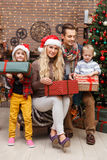 Smiling family with two children Royalty Free Stock Images