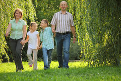 Smiling family with two children in park. Royalty Free Stock Photos