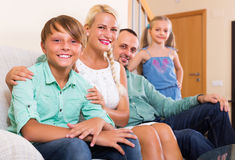 Smiling family with two kids Royalty Free Stock Photography