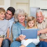 Smiling family using digital tablet Royalty Free Stock Images