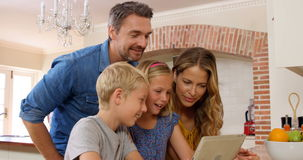 Smiling family using tablet. At home stock video