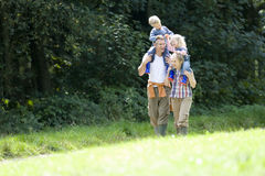 Smiling family walking together outdoors Stock Photography
