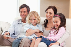 Smiling family watching television together Royalty Free Stock Photo