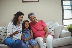 Smiling family watching television together in living room Royalty Free Stock Images