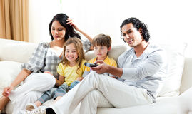 Smiling family watching TV Royalty Free Stock Photo