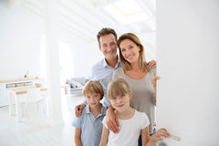 Smiling family welcoming guests Royalty Free Stock Photo