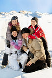 Smiling family in the winter Royalty Free Stock Image