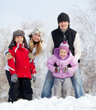 Smiling family in winter park. Happy family with children in winter park Stock Image