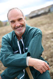 Smiling farmer standing in field Royalty Free Stock Photos