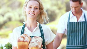 Smiling farmer woman holding breads. Portrait of a smiling farmer woman holding breads stock video