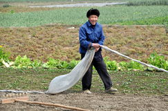 Smiling Farmer at Work in Field Stock Photography