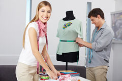 Smiling fashion designer in studio Royalty Free Stock Photo