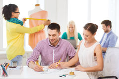 Smiling fashion designers working in office Stock Image