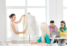 Smiling fashion designers working in office Stock Photography