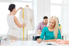 Smiling fashion designers working in office Stock Photos