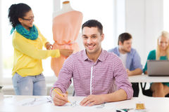 Smiling fashion designers working in office Royalty Free Stock Photo
