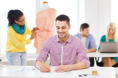 Smiling fashion designers working in office Royalty Free Stock Photos