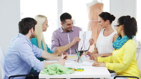 Smiling fashion designers working in office Stock Images