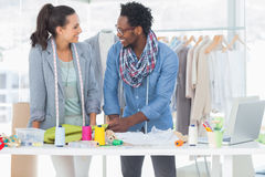 Smiling fashion designers working together Royalty Free Stock Photos