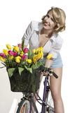 Smiling fashion girl on bicycle Royalty Free Stock Photo
