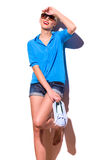 Smiling fashion girl with sneakers lean on the wall. Royalty Free Stock Photo