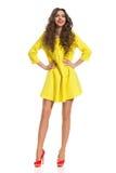 Smiling Fashion Girl In Yellow Mini Dress Stock Photo