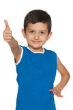 Little boy in blue holds his thumb up Royalty Free Stock Photography