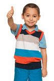 Smiling boy in striped shirt holds his thumb up Royalty Free Stock Photo