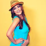 Smiling fashion model posing against yellow background. Woman portrait Royalty Free Stock Photos