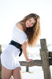 Smiling fashion model in winter farm. Picture of beautiful fashion model in winter farm Stock Photos