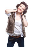 Smiling fashion woman in autumn apparel. On white background Royalty Free Stock Photo