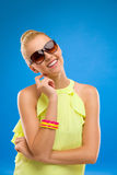 Smiling fashion woman in sunglasses on blue background. Stock Image