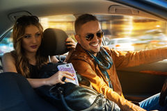 Smiling fashionable man is driving at full speed with a stunning Stock Images
