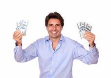 Smiling fashionable man holding cash money Stock Photos