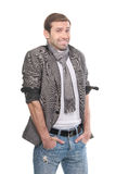 Smiling fashionable man wearing a scarf and gray clothes Stock Image