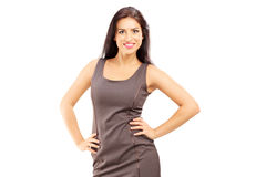 Smiling fashionable woman in dress posing Stock Images
