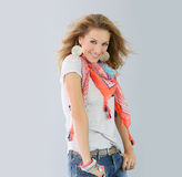 Smiling fashionable woman presenting new clothes collection Royalty Free Stock Photo