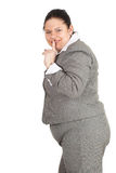 Smiling fat businesswoman keeping silence stock image