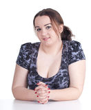 Smiling fat girl. Smiling fat beautiful young woman in dark dress Royalty Free Stock Photography