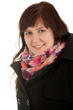 Smiling fat girl in winter clothes. White background Royalty Free Stock Photography