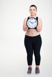 Smiling fat woman holding wall clock Stock Photo